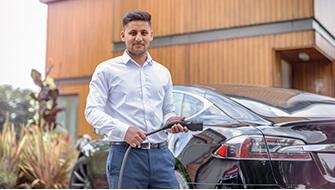 Man charging an electric car