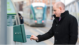 Man using Robin Hood Card on tram platfrom