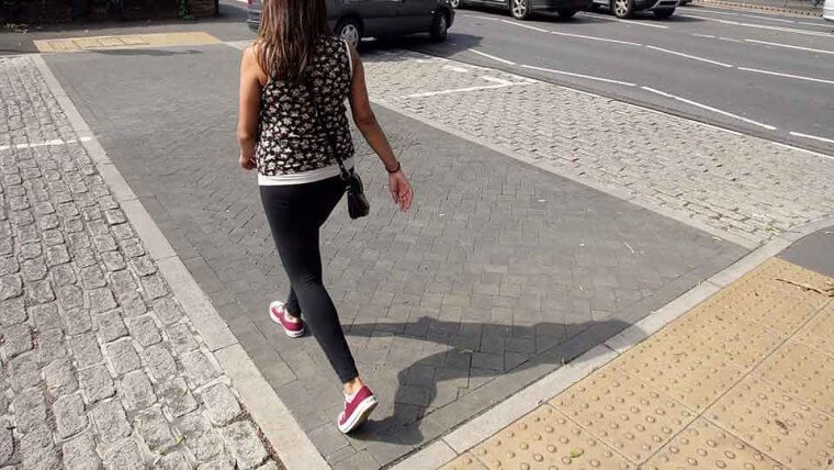Pedestrian walking across road nottingham