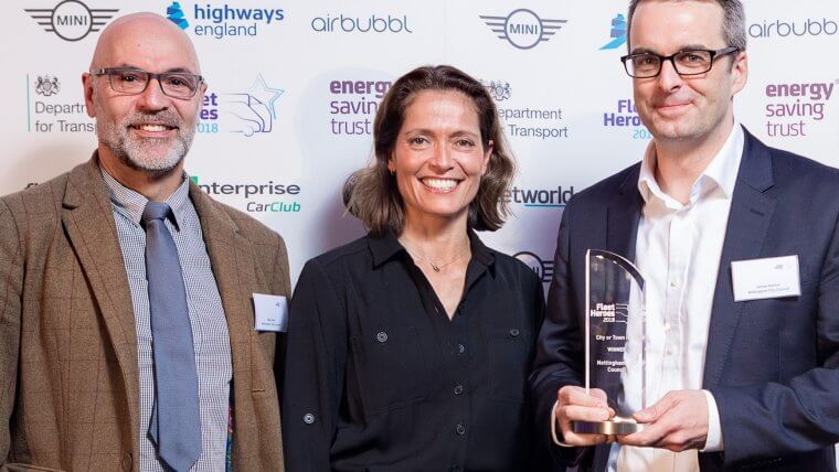 Senior Transport Planner Mark Daly and Transport Strategy Manager James Ashton are presented with the City Hero award by motoring journalist Amanda Stretton.