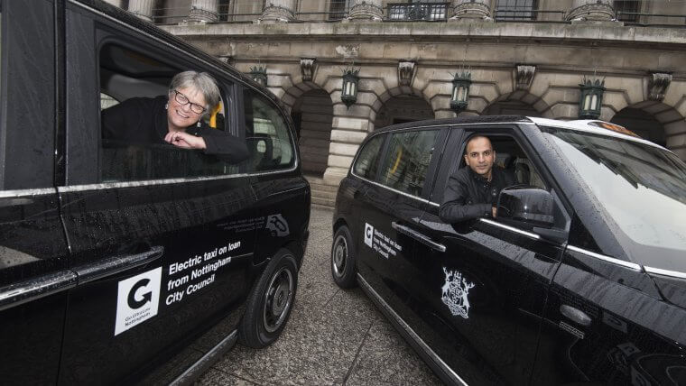 Cllr Sally Longford with taxi driver Amer Alam