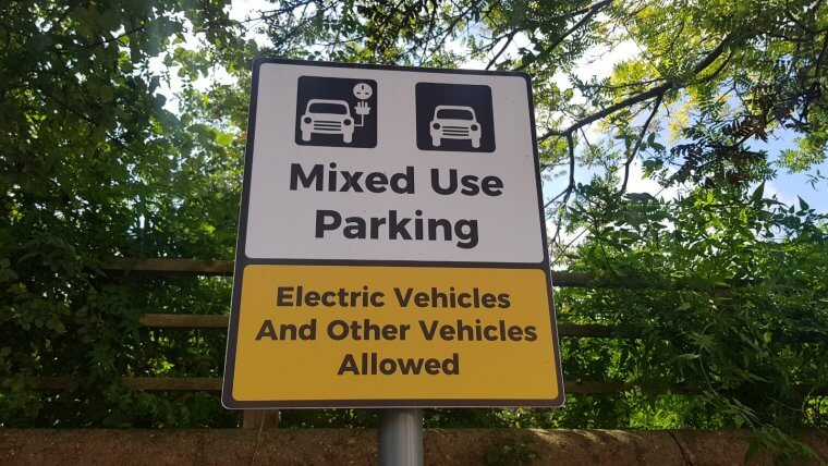 Mixed use parking sign for electric vehicle charging