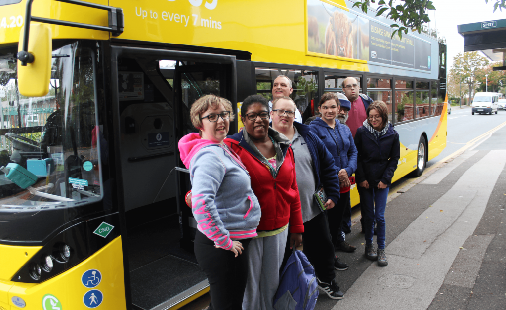 A group from Mencap with a yellow biogas bus