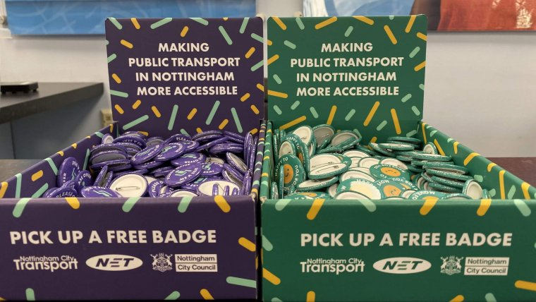 "Boxes of badges at NCT's travel centre for the ""please offer me a seat"" campaign"