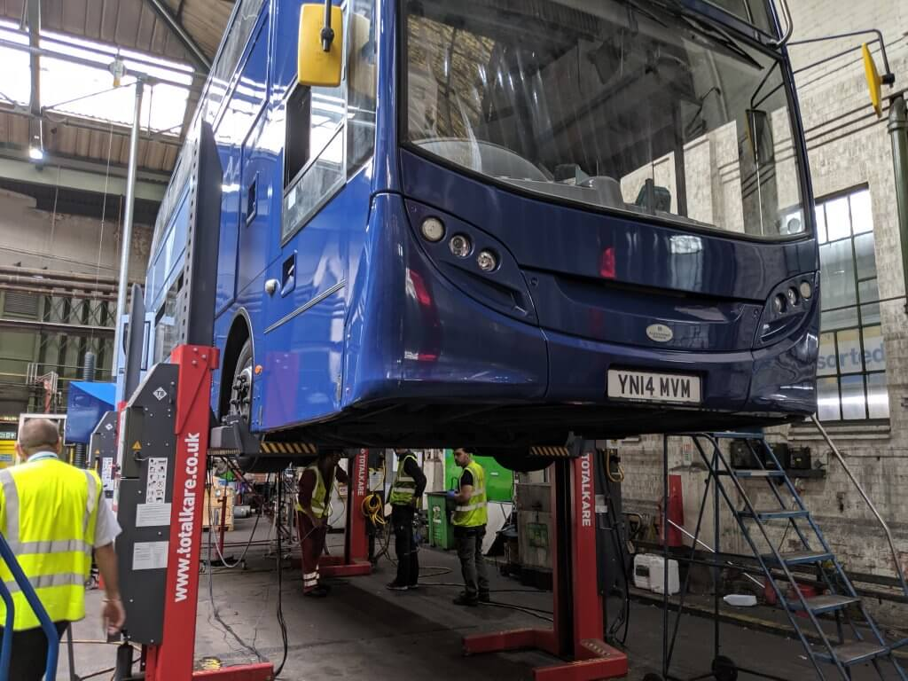 An NCT diesel bus having a device fitted to clean up its emissions