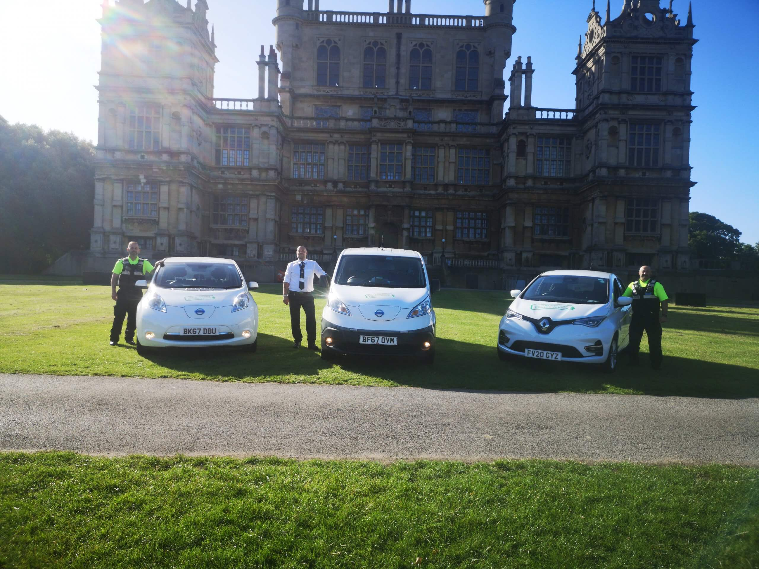 Three members of REACT with their electric vehicles