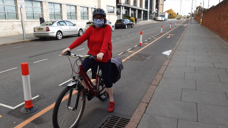Cllr Williams using the trial cycle lane on Station Street