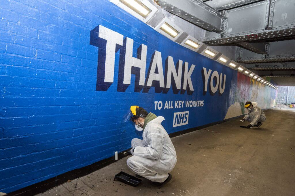 Volunteers put the finishing touches to the mural