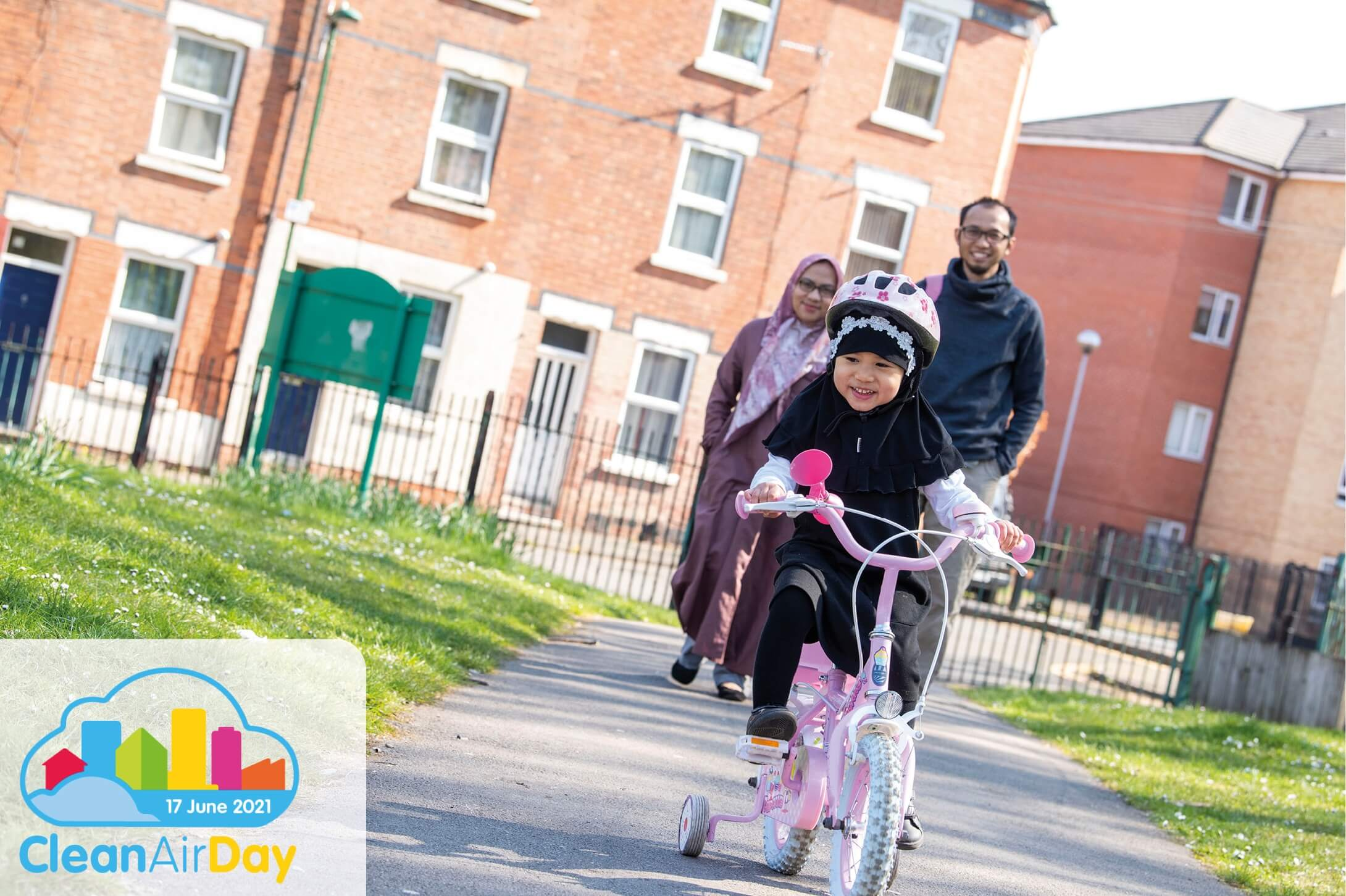 Family cycling to school