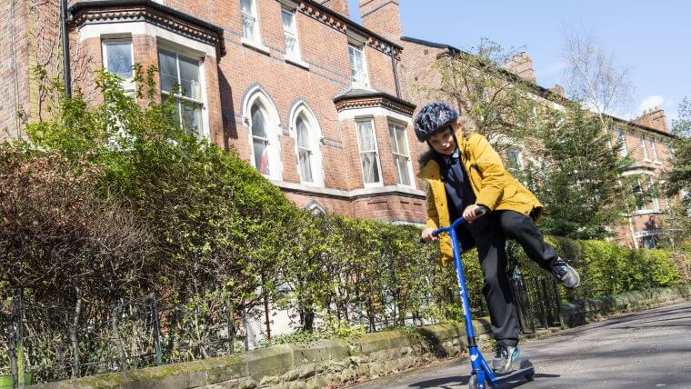 A child scoots to school in Nottingham
